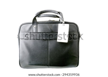 Close up shot of a black leather briefcase with a tag on a white background
