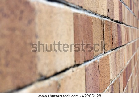 Close up shot of a brick wall with a shallow depth of field focus. - stock photo