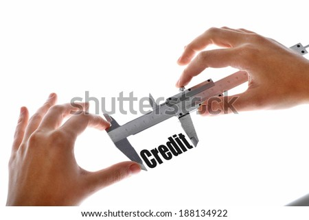 "Close up shot of a caliper measuring the word ""Credit"" - stock photo"