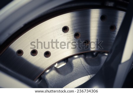 Close-up shot of a car's brake disc.  - stock photo