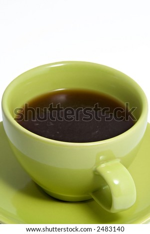 Close up shot of a green coffee cup and saucer, containing black coffee.