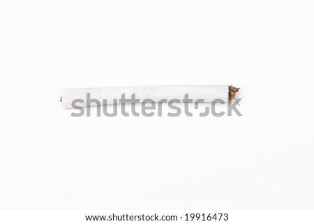 close up shot of a handrolled cigarette (shag) on a white background with clipping Path - stock photo