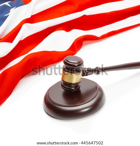 Close up shot of a judge gavel near flag of Unites States of America
