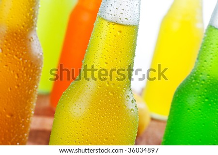 Close up shot of a lot of bottles with ice cold beverages