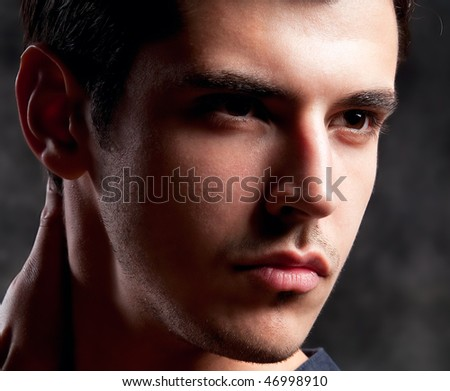 Close up Shot of a macho Man. A trendy European man dressed in contemporary cloth. He is now a professional model.