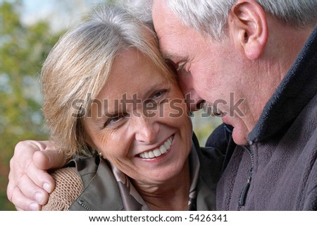 Close-up shot of a mature couple laughing - stock photo