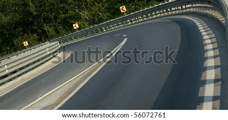 close up shot of a road curve - stock photo