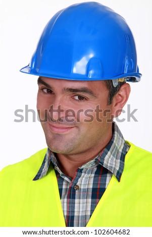 Close-up shot of a smiling tradesman - stock photo