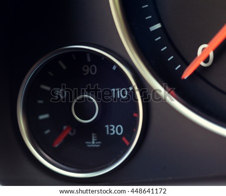Close up shot of a speedometer in a car