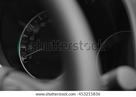 Close up shot of a speedometer in a car with blur foreground steering wheel - stock photo