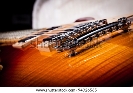 Close up Shot of a Sunburst Electric Guitar Laying In a Hard Shell Electric Guitar Case
