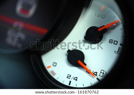 Close up shot of a the fuel indicator and coolant temperature, in a car - stock photo