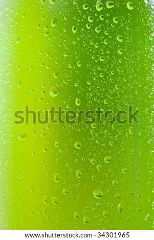 Close up shot of a wet bottle with tropical drink - stock photo