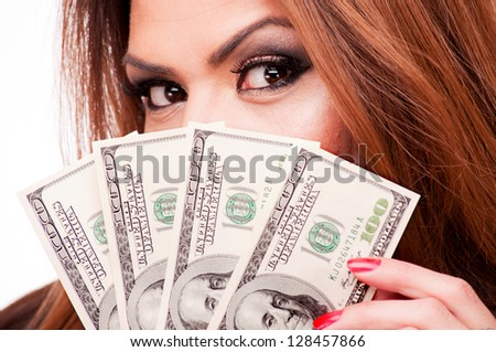 Close up shot of a woman holding a fan of hundred-dollar bills - stock photo