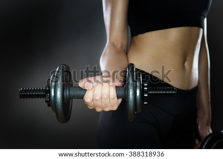 close up shot of a woman working out using weights - stock photo