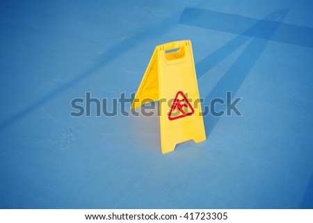 close up shot of a yellow caution on floor - stock photo