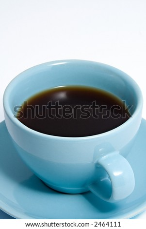 Close up shot of an blue coffee cup and saucer, containing black coffee. - stock photo