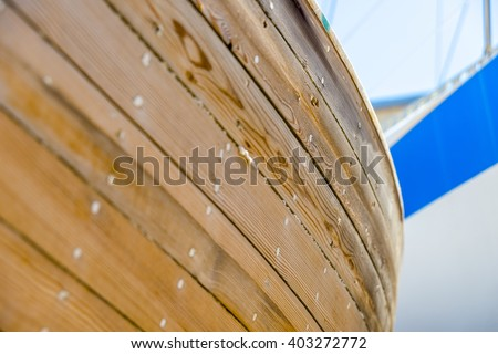 Close-up shot of an old fishing boat. Vintage scenery in a small, traditional shipyard. - stock photo