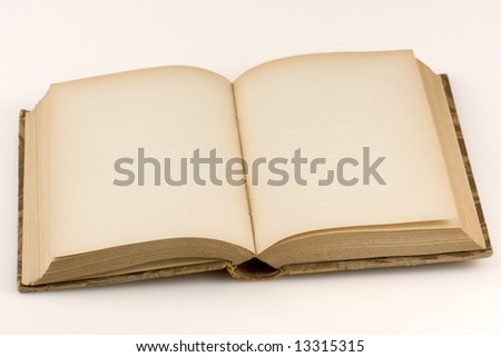 Close up shot of an open antique book, on white background - stock photo