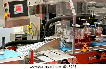 Close up shot of automated packaging machine