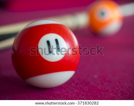 close up shot of 11 Ball from pool or billiards on a billiard table. Selective Focus - stock photo