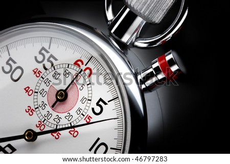 Close up shot of  beautiful stopwatch shot on black background with space for copy - stock photo