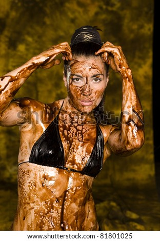 Close-up shot of beautiful woman body  with chocolate, Conceptual image. Looking like filth - stock photo