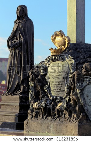 Close up shot of bronze board on Charles Bridge in Prague. Statue on Charles bridge, Czech republic  - stock photo