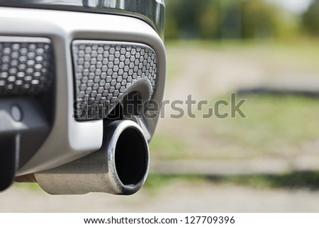 Close up shot of car exhaust pipe - stock photo