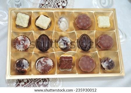close up shot of chocolates in box. Box of chocolates - stock photo