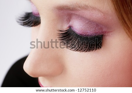 Close-up shot of closed eyes with huge false eyelashes