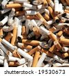 close up shot of dirty cigarettes butts in ashtray - stock photo