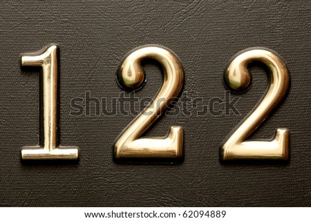Close up shot of door with numerals 122. - stock photo