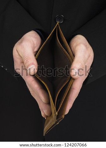 Close-up shot of empty brown leather wallet - stock photo
