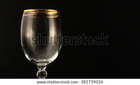 Close up shot of empty wine glass on black background. - stock photo