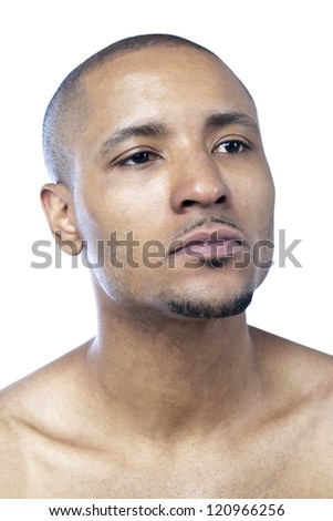Close-up shot of face of a shirtless man looking away over the white background