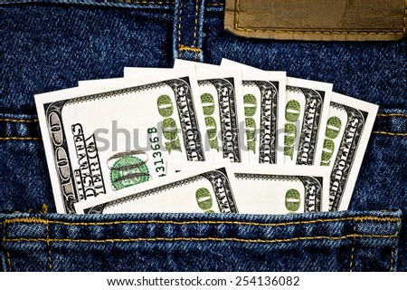 Close Up Shot Of Fake Hundred Dollar Bills In Jean Pocket/ Money In The Pocket - stock photo
