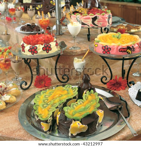 close up shot of fancy cakes at the buffet - stock photo
