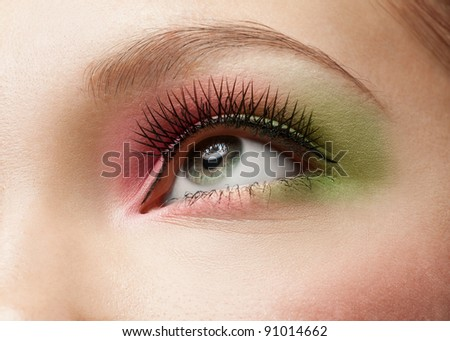 Close-up shot of female eye with bright creativity makeup