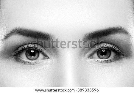 Close-up shot of female eyes makeup black and white