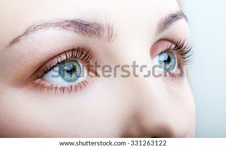 Close-up shot of female face with eyes makeup - stock photo