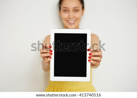 Close up shot of female hands holding digital tablet with blank copy space screen for your text or advertising content. Smiling woman showing blank tablet computer on white background. Selective focus - stock photo