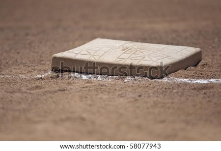 Close up shot of first base on a baseball field - stock photo
