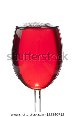 Close-up shot of glass full of red wine isolated over white background - stock photo