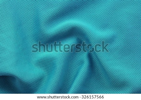 Close up shot of green textured football jersey - stock photo