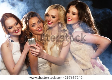 Close-up shot of group of laughing girls having party, take selfie with smartphone