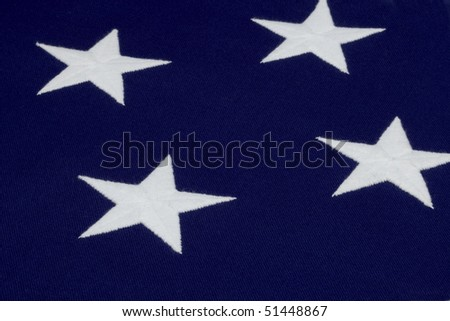 Close up shot of 4 hand sewn stars on an American flag - stock photo