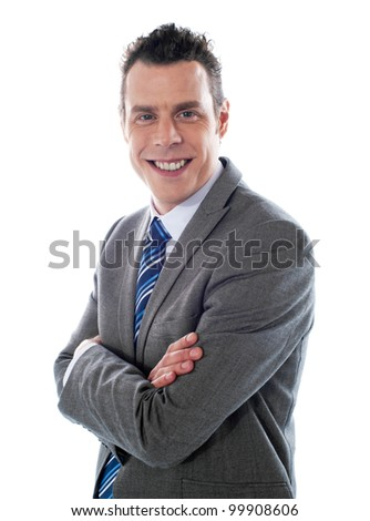 Close-up shot of handsome executive posing with folded arms - stock photo