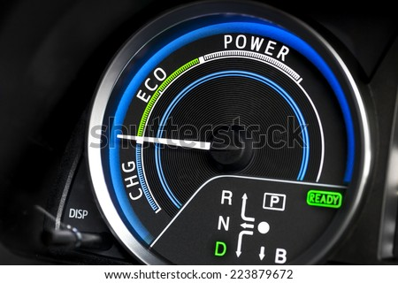 Close up shot of hybrid car instrument panel - stock photo