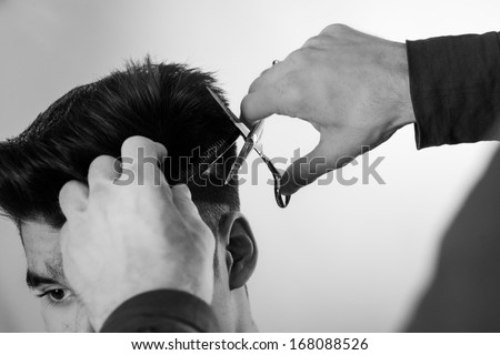 close up shot of man getting his hair cut - stock photo